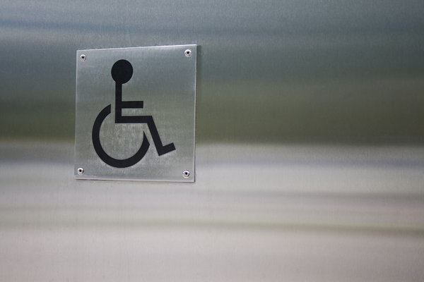 Wheelchair symbol on a silver metal wall